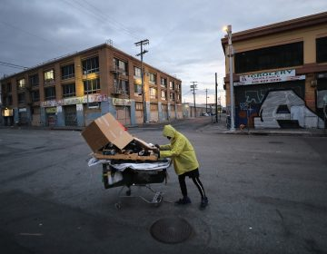 A homeless man pushes his belongings along a Los Angeles street. (Mario Tama/Getty Images)