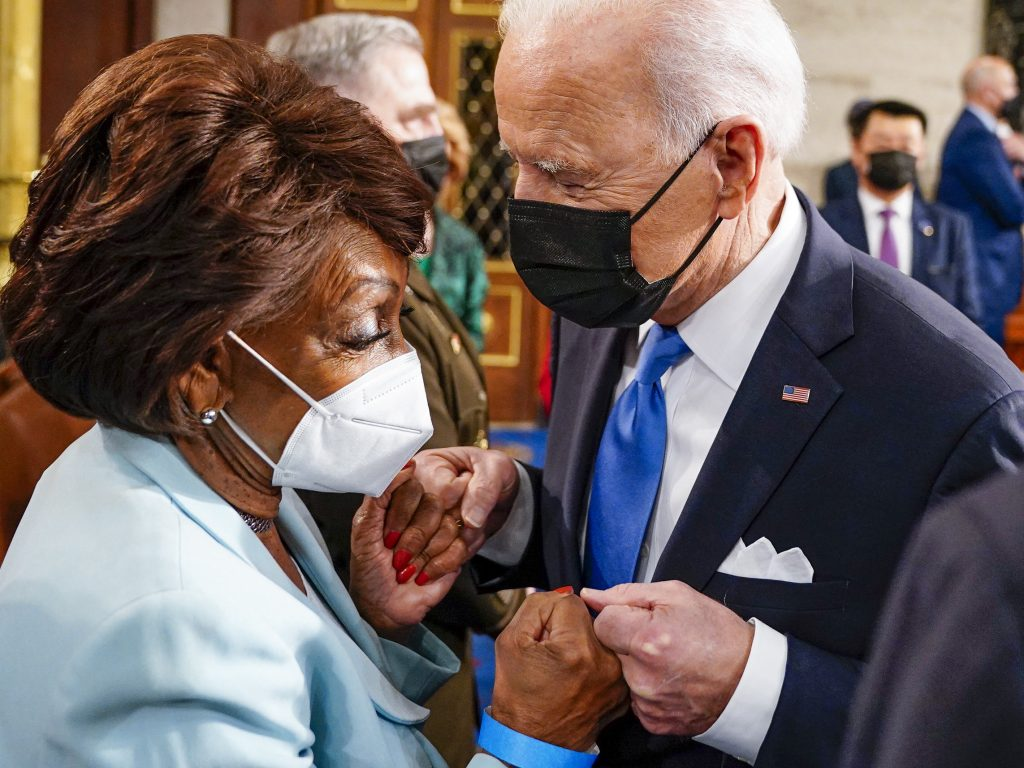 Rep. Maxine Waters fist bumps President Biden at the Capitol on April 28. In an interview with NPR, Waters warns banks she will not be undermined. (Melina Mara/Pool/AFP via Getty Images)