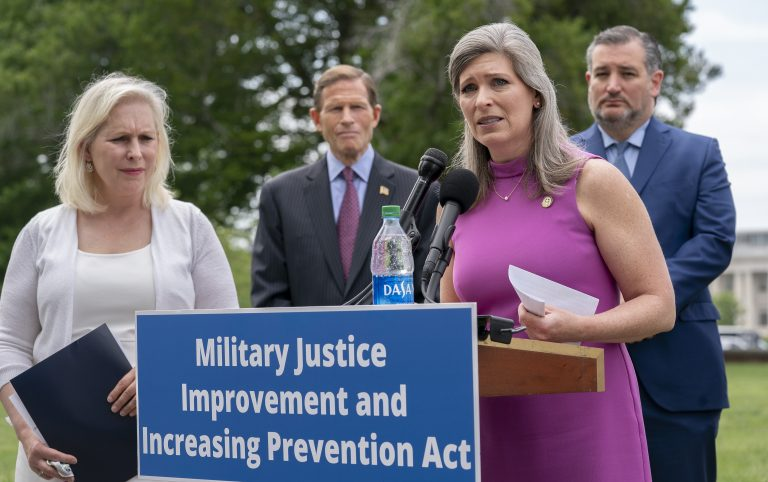 For years, New York Democratic Sen. Kirsten Gillibrand (left) has sought approval of her bill to reform the military's criminal justice system. This year, Gillibrand joined forces with Iowa Republican Sen. Joni Ernst, seen here, a sexual assault survivor herself before she became a combat company commander. (Stefani Reynolds/Getty Images)