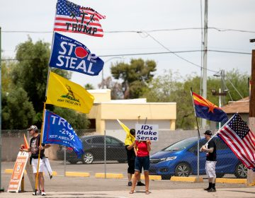 Demonstrators in support of former President Donald Trump gather on May 1 outside the Arizona Veterans Memorial Coliseum in Phoenix, where a controversial 2020 general election review was set to begin. Trump has heartily supported the audit. (Courtney Pedroza/Getty Images)