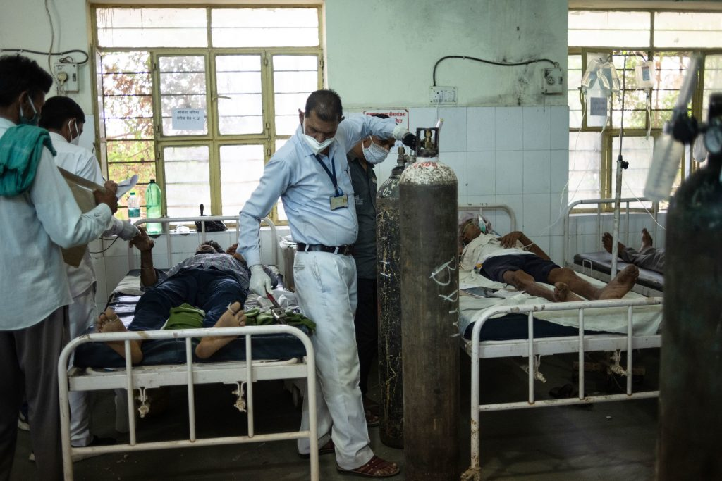 Medical attendant Gurmesh Kumawat prepares to administer supplemental oxygen to a coronavirus patient in the emergency ward at the BDM Government Hospital last week in Kotputli, Jaipur District, Rajasthan, India. (Rebecca Conway/Getty Images)