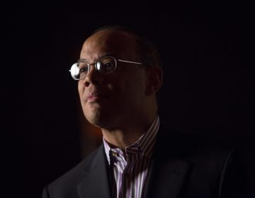 John Rogers, co-CEO of Ariel Investments, stands for a Bloomberg Television spot in Atlantic City, N.J., July 22, 2013. Rogers tells NPR about the emotional and financial impact the Tulsa riots had on his family. (Scott Eells/Bloomberg via Getty Images)