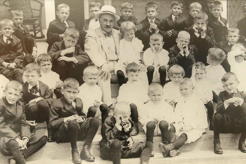 Milton Hershey and the early students of the school that bears his name in 1913. (Courtesy of Milton Hershey School)