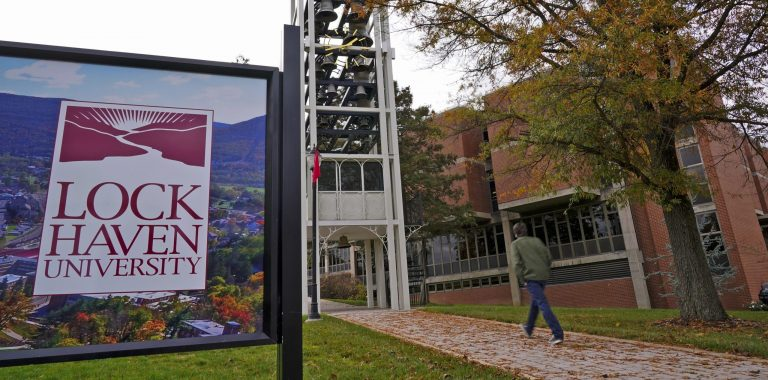 A student walks on the Lock Haven University campus in Lock Haven, Pa, Saturday, Oct. 31, 2020. (Gene J. Puskar/AP Photo)
