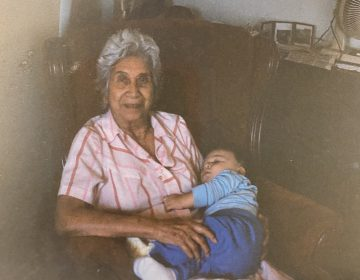 Sean Brown (Seminole Nation of Oklahoma) as an infant with his great-grandmother, Mable Brown (Mama-on), who would tell him countless stories about the people he came from. (Photo courtesy of Sean Brown)