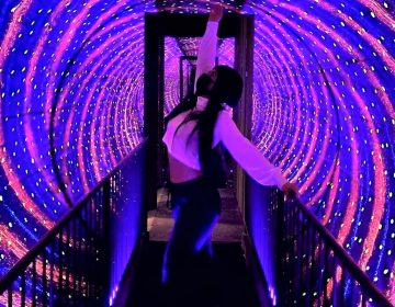A Museum of Illusions visitor strikes a pose in the vortex tunnel