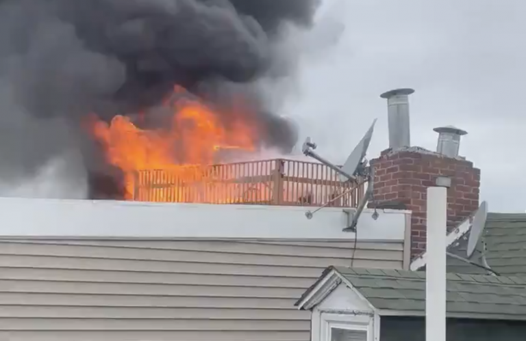 A fire is seen from the roof of a Northern Liberties home