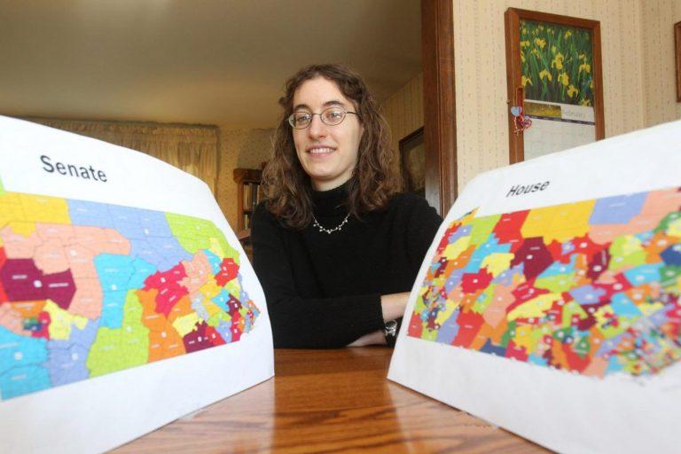 Amanda Holt holds up Pa. House and Senate maps