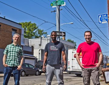 Ben Keys (left), Tyrique Glasgow (center), and Joshua Isserman (right), stand at the intersection of Tasker and Taney streets