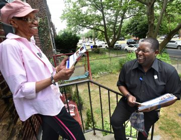 On May 25, Camden mayoral candidate Elton Custis explains his candidacy to resident Betty Sharp in the Yorkship neighborhood of the city. After speaking to Custis, Clark, a retired social worker, said,
