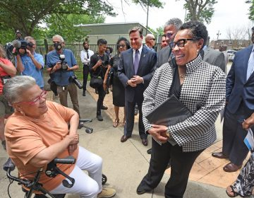 HUD Secretary Marsha Fudge chats with Ablett Village resident Maria Gonzalez at the announcement of the the CHOICE grant on June 2, 2021; to the left of Fudge are US Rep. Donald Norcross and interim Camden Mayor Vic Carstarphen. (Photo by April Saul for WHYY)