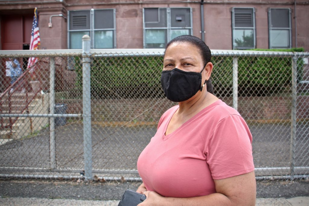 Altagracia De La Cruz wears a face mask outside