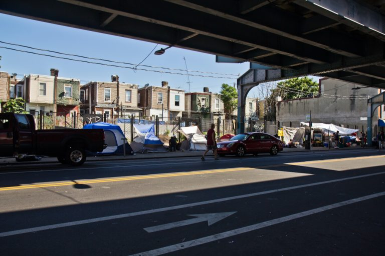 Tents set up by people experiencing homelessness along Kensington Avenue