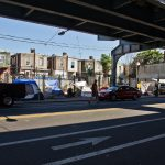 Tents set up by people experiencing homelessness along Kensington Avenue in Philadelphia's Kensington neighborhood on the morning of June 16, 2021. (Kimberly Paynter/WHYY)