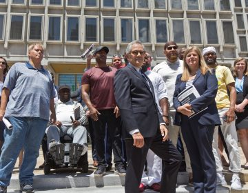 """Philadelphia District Attorney Larry Krasner, the office's CIU (Conviction Integrity Unit), and exonerees stood at the site of the statue of former Philadelphia Mayor Frank Rizzo, which was removed from Thomas Paine Plaza last year, calling the release of a report on wrongful convictions in the city on June 15, 2021, """"an end of an era."""" (Kimberly Paynter/WHYY)"""