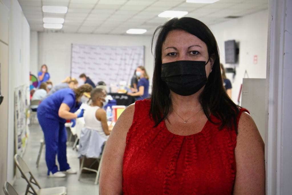 June Sieber poses while wearing a black face mask