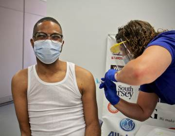 Sean Brown receives a COVID-19 vaccine