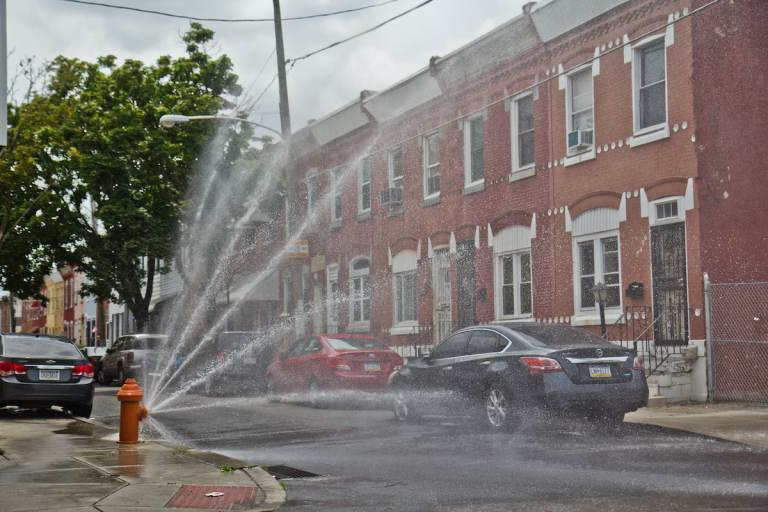 A hydrant is open at Reese and Cumberland streets