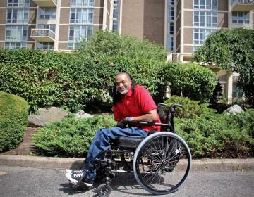 Charles Horton sits in a wheelchair outside