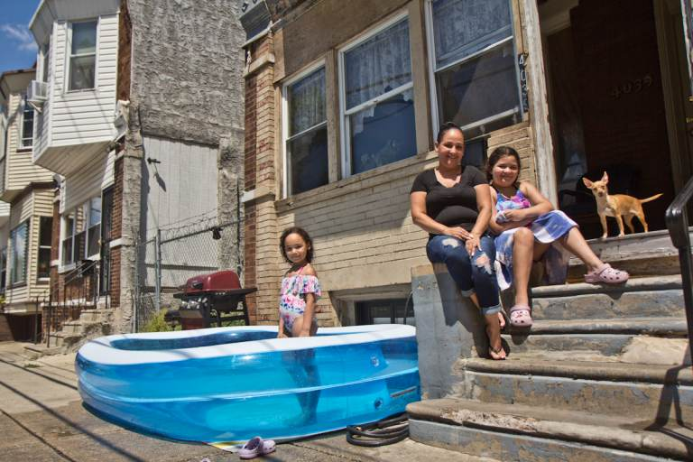 Jassy Perez has lived in the Hunting Park section of Philadelphia for over 30 years. She used to take her kids, Juliani Morell, 6, and Zeahani Morell, 10,  to the neighborhood pool twice a week. (Kimberly Paynter/WHYY)