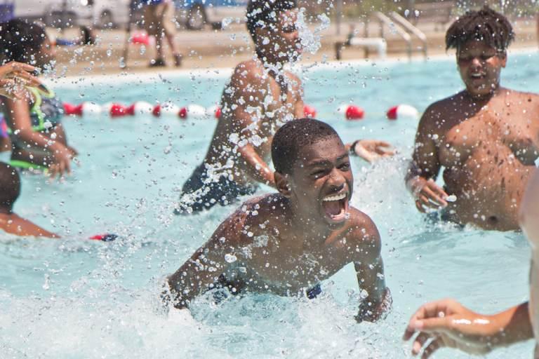 Kids swim at the James Finnegan Playground pool
