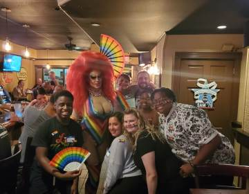 Pride Night at 2312 Garrett Bar in Upper Darby, 2021. It was the first Pride related event hosted by U.D.T.J. Bottom row from left to right: Elijah Neal, Ashely Rose, Valentina Kariouk, Dyamond Gibbs, BJ Bryant.  Top row, left to right: Ophelia Hotass, Kyle McIntyre, name unknown. Minus Ophelia, the other people are the organizers of the Pride Festival and members of UDTJ. (Courtesy of UDTJ)