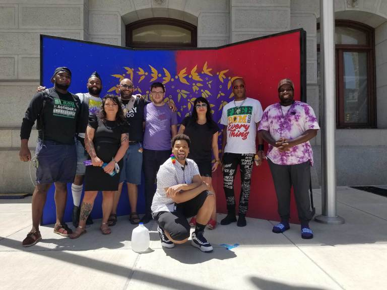 Members of ad hoc group reimagining a new Pride in Philly. L - R: Maso Kibble, Diamond Anthony, Jessica Kallup, Manny Frank-Lampon, Rich Frank-Lampon, André Henson aka Alzei Barbei Mizrahi, Elicia Gonzales, Jamaal Henderson, and Abdul-Aliy Muhammad. (Peter Crimmins / WHYY)