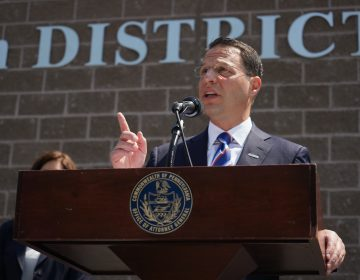 Pennsylvania Attorney General Josh Shapiro speaks from behind a podium