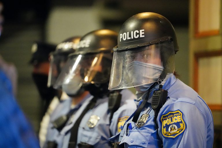 Philadelphia police stand in position during a march by protesters Tuesday Oct. 27, 2020 in Philadelphia. Hundreds of demonstrators marched in West Philadelphia over the death of Walter Wallace, a Black man who was killed by police in Philadelphia. (AP Photo/Matt Slocum)