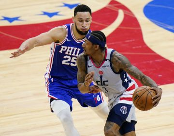Washington Wizards' Bradley Beal, right, tries to get past Philadelphia 76ers' Ben Simmons during the second half of Game 5 in a first-round NBA basketball playoff series, Wednesday, June 2, 2021, in Philadelphia. (AP Photo/Matt Slocum)