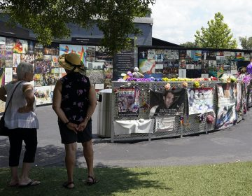 Visitors pay tribute to the display outside the Pulse nightclub memorial Friday, June 11, 2021, in Orlando, Fla. Saturday will mark the fifth anniversary of the mass shooting at the site. (AP Photo/John Raoux)
