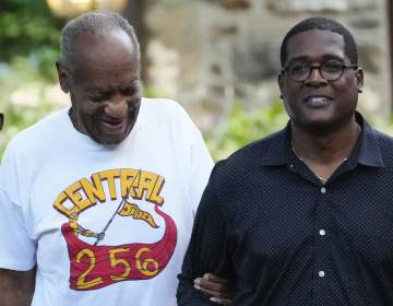 Comedian Bill Cosby, left, and spokesperson Andrew Wyatt approach members of the media gathered outside the home of the entertainer in Elkins Park, Pa., Wednesday, June 30, 2021.  (AP Photo/Matt Slocum)
