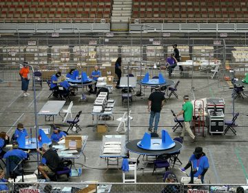 Maricopa County ballots cast in the 2020 general election are examined and recounted by contractors