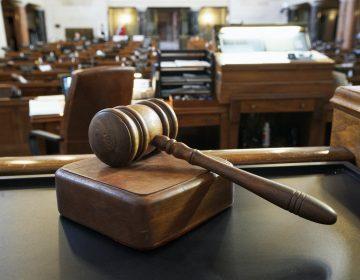 A closeup of a gavel inside a court room