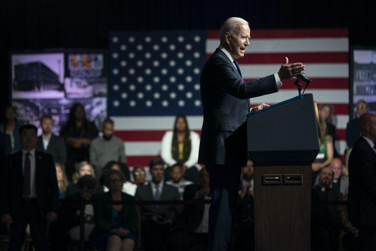 President Joe Biden gestures while speaking from behind a podium