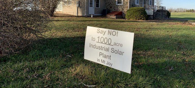One of the many signs protesting a proposed solar project in Mount Joy Township, Adams County is seen here in front of the Iron Horse Inn on Nov. 24, 2020. Owner Tom Newhart said the project could hurt the tourism industry in the area, just outside Gettysburg. (Rachel McDevitt / StateImpact Pennsylvania)
