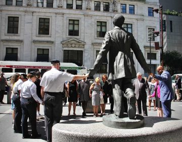 City officials and members of the Pathways to Reform, Transformation and Reconciliation steering committee join hands at the Octavius Catto statue for a moment of silence. The committee was formed after the murder of George Floyd and the civil unrest that followed. (Emma Lee/WHYY)