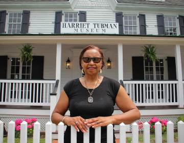 Lynda Anderson-Towns stands outside the museum on Lafayette Street