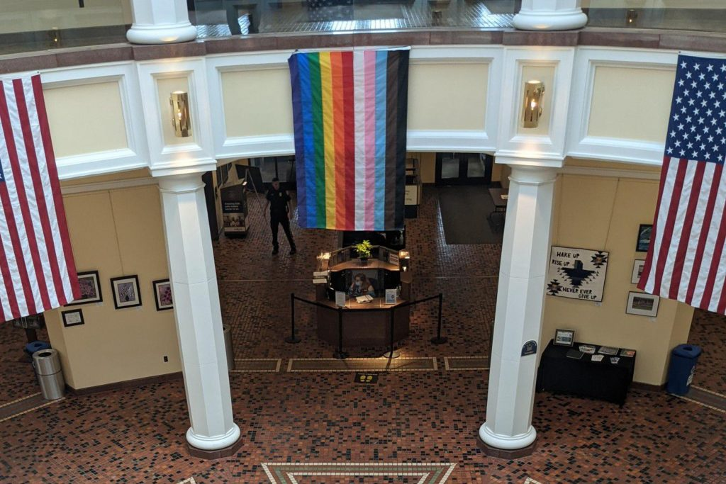 An LGBTQ pride flag hanging inside the Capitol's East Wing Rotunda