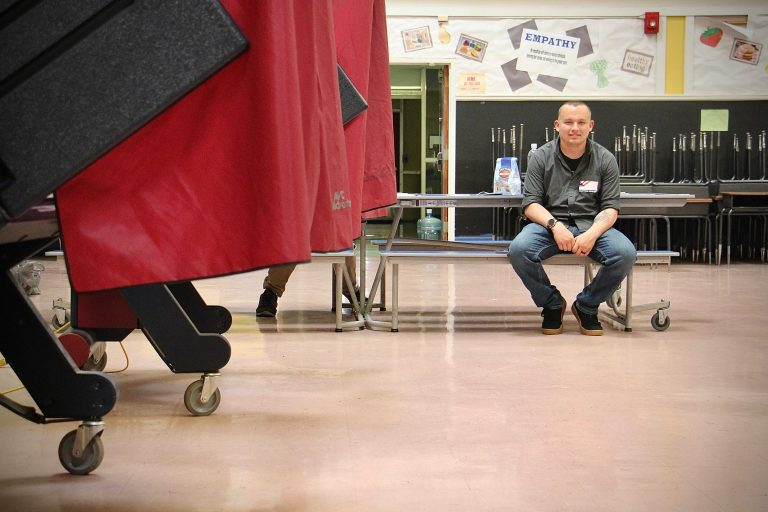 National Guardsman Tim Rzemyk helps out at a polling place