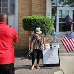 Tanya Ross poses for a picture outside a polling place
