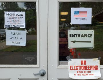 Doors to a N.J. polling station are covered in signs saying,