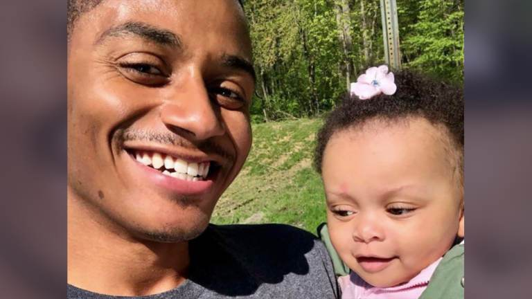 """Marquise Dogan poses with his daughter Mylan. """"We have to understand as parents, it's all about our children,"""" he said. (Philadelphia Tribune)"""