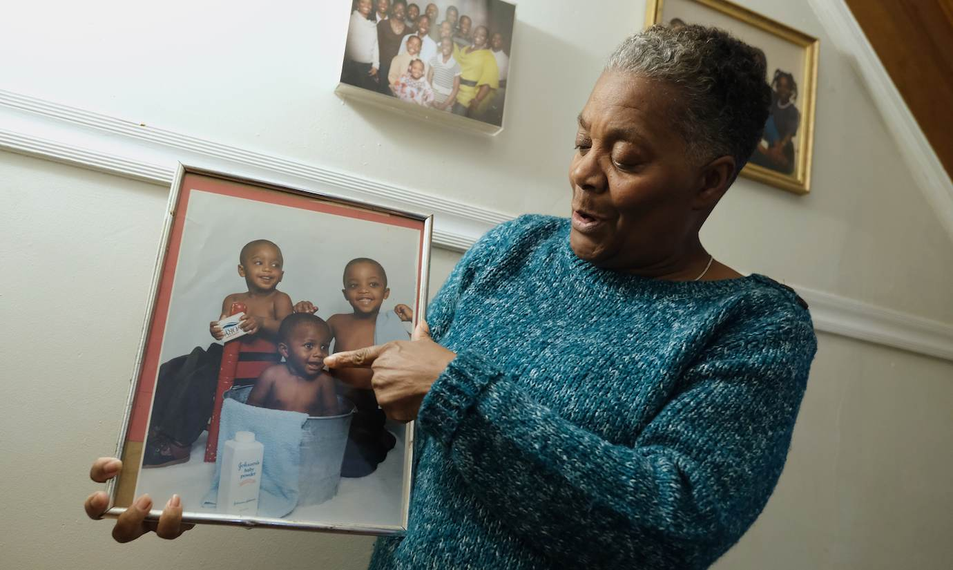 Joanne Henderson points to a picture of her son, Shakoor, as a baby. (Photo by Matt Smith)