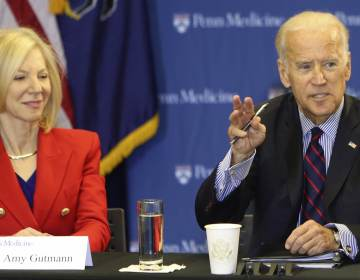 Joe Biden, at the time a former VP, with Amy Gutmann during a roundtable discussion in the Abramson Cancer Center at the University of Pennsylvania in 2016 JOSEPH KACZMAREK / AP PHOTO