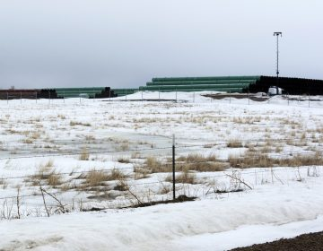 A storage yard is seen in Montana for pipe that was to be used in the construction of the Keystone XL oil pipeline. The developer has now canceled the controversial project. (Al Nash/Bureau of Land Management via AP)