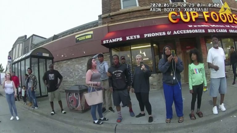 A police body camera image shows bystanders including Darnella Frazier (third from right filming) as former Minneapolis police officer Derek Chauvin was recorded pressing his knee on George Floyd's neck in Minneapolis. (Minneapolis Police Department via AP)