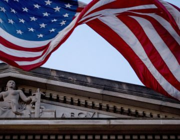 An American flag flies outside the Department of Justice