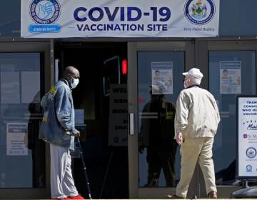 A COVID-19 vaccination clinic last month in Auburn, Maine. A drop in life expectancy in the U.S. stems largely from the coronavirus pandemic, a new study says. (Robert F. Bukaty/AP)