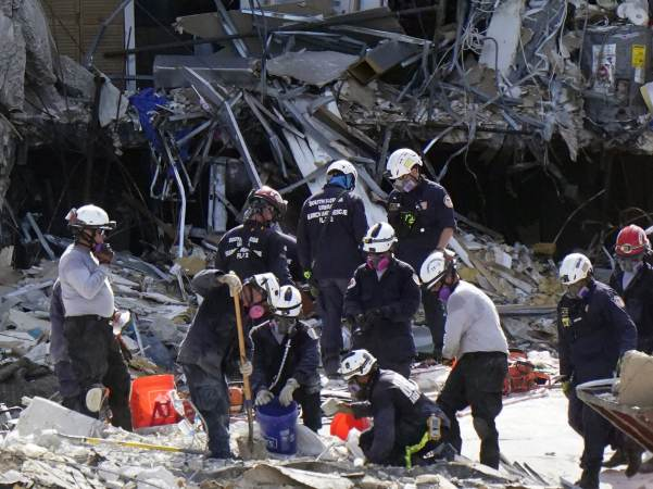 Crews work in the rubble at the Champlain Towers South Condo